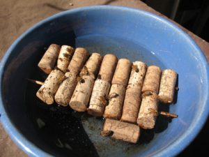 Simple bee-water system using wine corks pre-drilled and skewered.